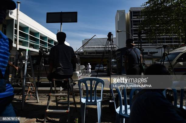 Members of the media wait opposite the gate of the forensics wing of the Hospital Kuala Lumpur where the body of Kim JongNam lies in Kuala Lumpur on...