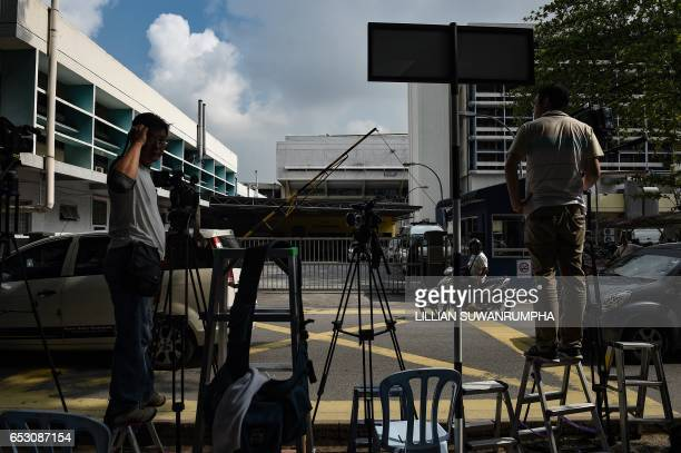 Members of the media wait opposite the gate of the forensics wing of the Hospital Kuala Lumpur where the body of Kim JongNam is being held in Kuala...