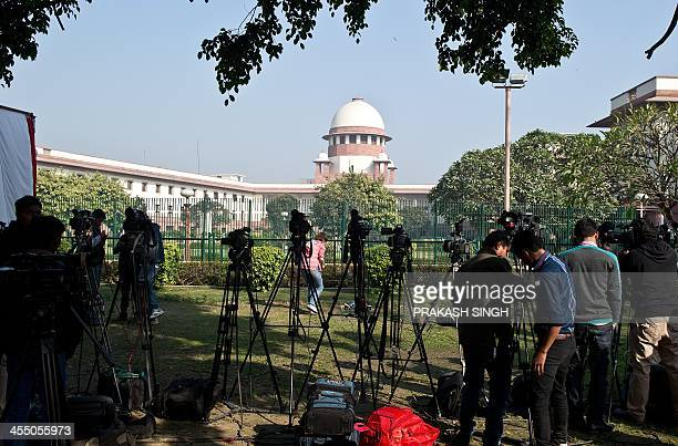 Members of the media wait outside the Supreme Court for news of the verdict over a law criminalising gay sex in New Delhi on December 11 2013 India's...