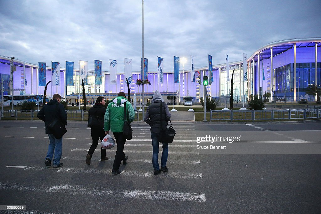 Members of the media walk towards the Main Press Centre ahead of the Sochi 2014 Winter Olympics at the Olympic Park on February 5 2014 in Sochi Russia