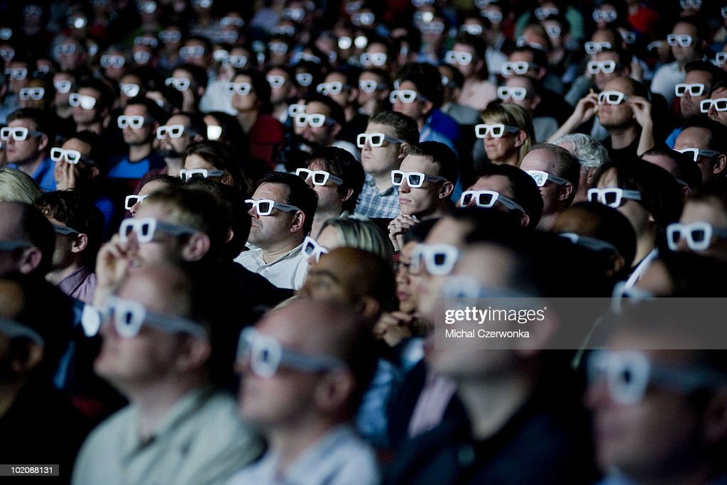 Members of the media watch a 3D trailer for 'Crysis 2,' a new game from Electronic Arts (EA), at an EA press briefing ahead of the Electronic Entertainment Expo (E3) at the Orpheum Theater June 14, 2010 in Los Angeles, California. The annual video game trade conference and show at the Los Angeles Convention center runs June 15-17.