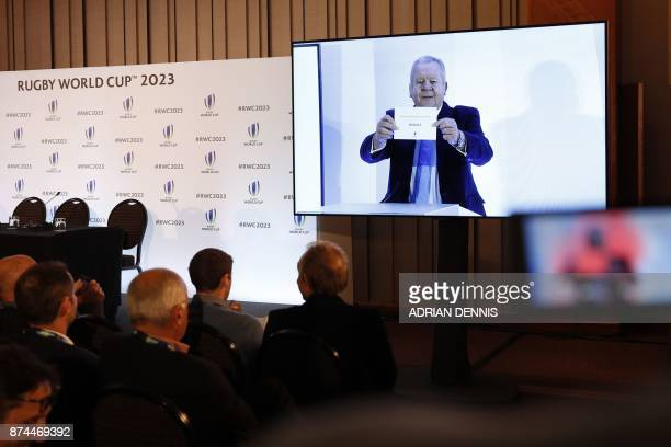 Members of the media watch a live relay as France is named to host the 2023 Rugby World Cup in London on November 15 2017 / AFP PHOTO / Adrian DENNIS