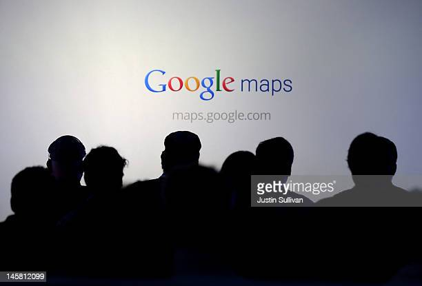Members of the media watch a slideshow during a news conference about Google Maps on June 6 2012 in San Francisco California Google announced new...