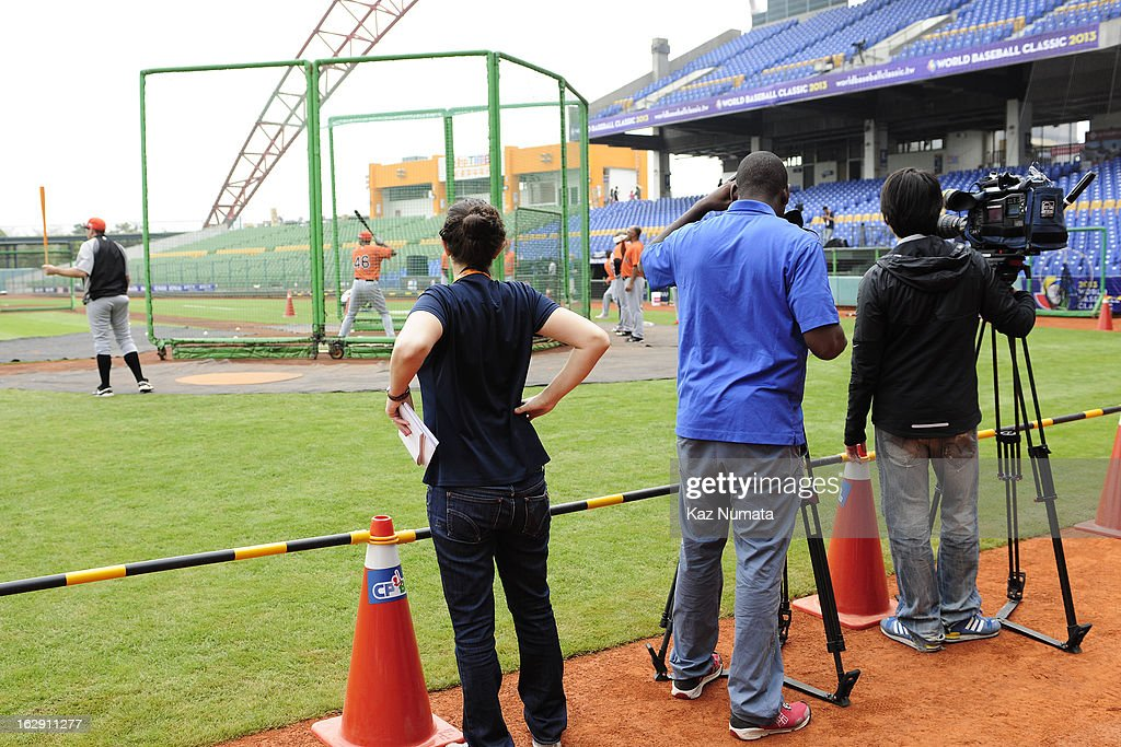 Members of the media watch Team Netherlands take batting practice during the World Baseball Classic workout day at Taichung Intercontinental Baseball Stadium on March 1, 2013 in Taichung, Taiwan.