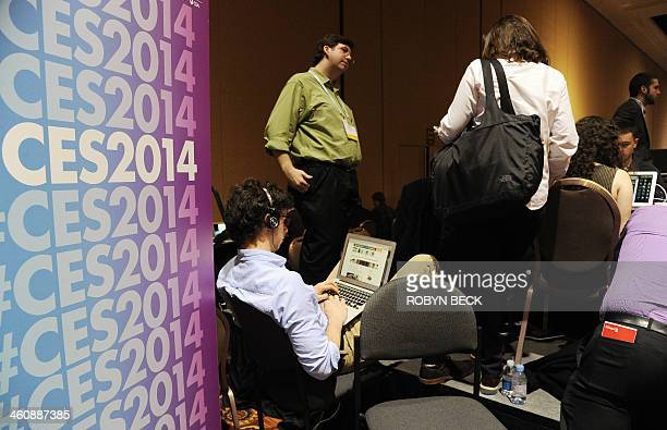 Members of the media work at the 'CES Unveiled' media preview for International CES at the Mandalay Bay Convention Center in Las Vegas on January 5...