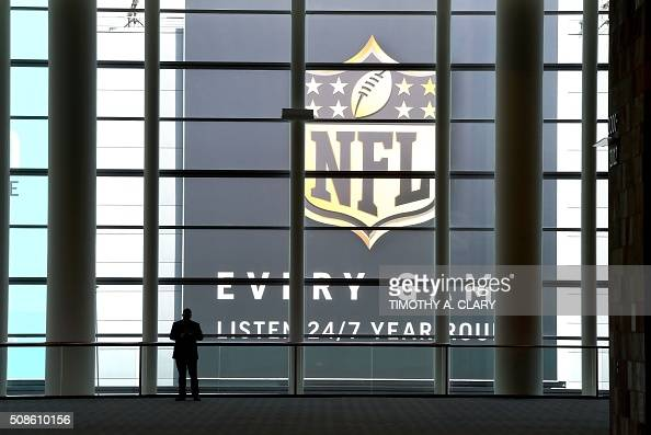 Members of the media work at the media center for the Super Bowl 50 at the Moscone Convention Center in San Francisco on February 5 2016 / AFP /...