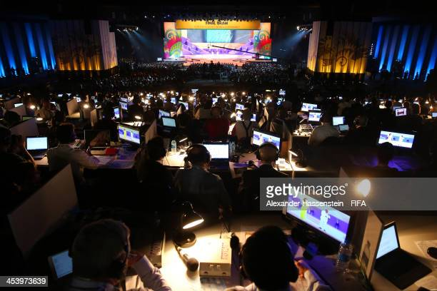 Members of the media work during a performance on stage during the Final Draw for the 2014 FIFA World Cup Brazil at Costa do Sauipe Resort on...