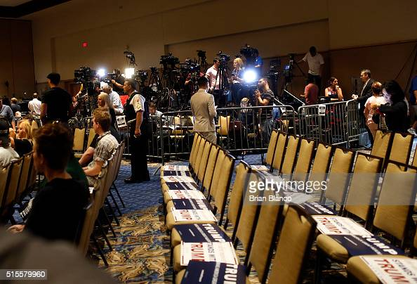 Members of the media work inside the designated media pen as they wait for Republican presidential candidate Donald Trump to arrive at a town hall...