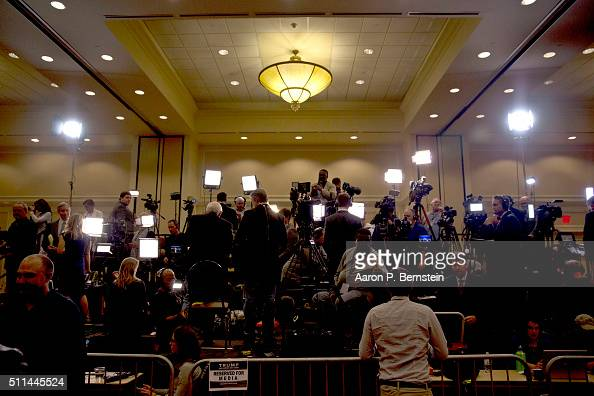 Members of the media work prior to Republican presidential candidate Donald Trump speaking at his election night party February 20 2016 in...