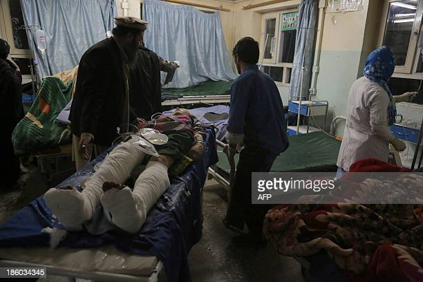 Members of the medical staff take care of victims of a roadside bomb at a hospital in the Andar district of the Ghazni province on October 27 2013 A...