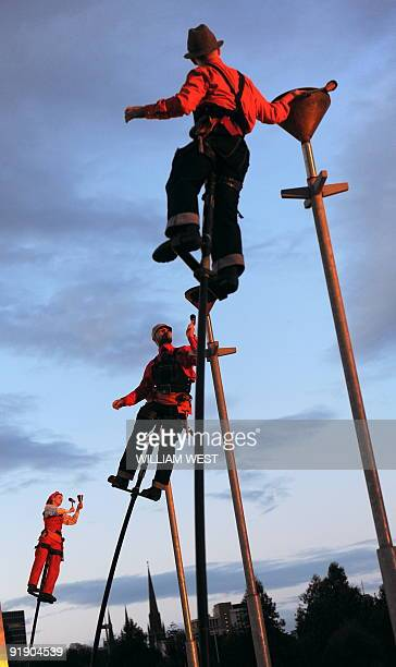 Members of the Melbourne outdoor theatre group Strange Fruit perform 'Ringing the Changes' which sees the performers perched atop fivemetre poles and...