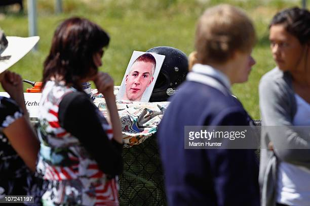 Members of the memorial service look on during a national memorial service for the 29 miners that lost their lives in the Pike River Mine at Omoto...