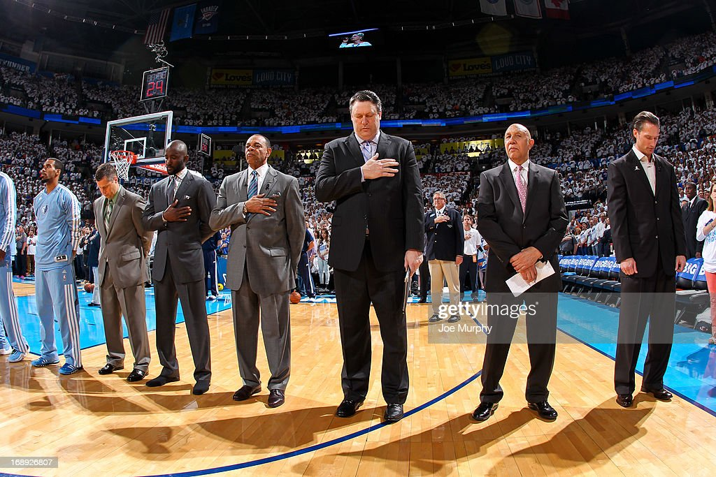 Members of the Memphis Grizzlies coaching staff listen to the National Anthem before the team played against the Oklahoma City Thunder in Game Five of the Western Conference Semifinals during the 2013 NBA Playoffs on May 15, 2013 at the Chesapeake Energy Arena in Oklahoma City, Oklahoma.