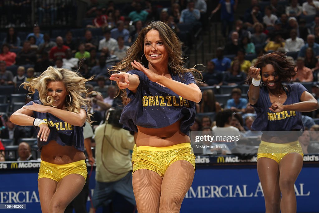 Members of the Memphis Grizzlies Dance team get the crowd pumped up against the Los Angeles Clippers on April 13, 2013 at FedExForum in Memphis, Tennessee.