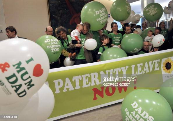 Members of the MEP greens party and their children demonstrate in support of the party's bid for fathers to obtain two weeks fully paid paternity...