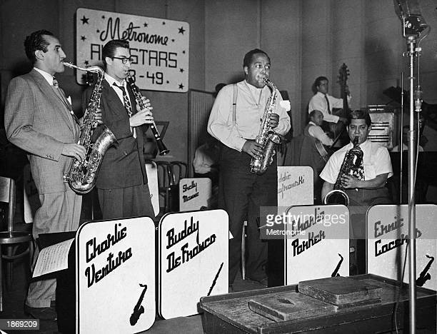 Members of the Metronome All Stars perform on stage c 1949 LRTenor saxophonist Charlie Ventura clarinetist Buddy De Franco and alto saxophonist...