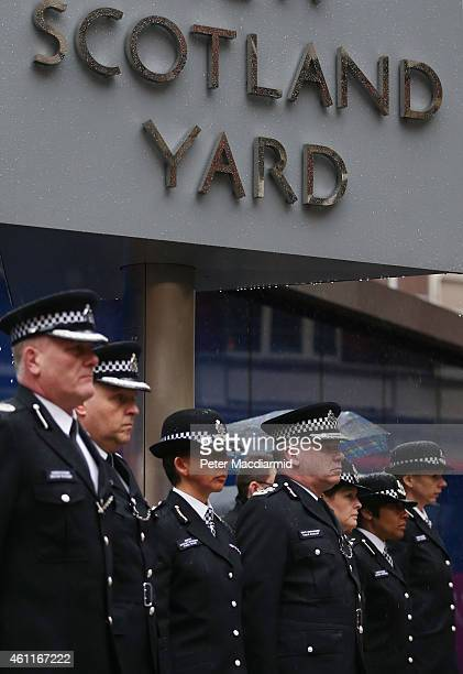 Members of the Metropolitan Police Service observe two minutes silence at New Scotland Yard on January 8 2015 in London England France is on maximum...
