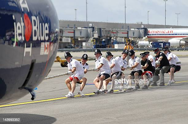 Members of the Metropolitan Police Services in London pull a Jet Blue A320 plane 100 feet during the third annual Jet Blue Airbus A320 Plane Tug at...