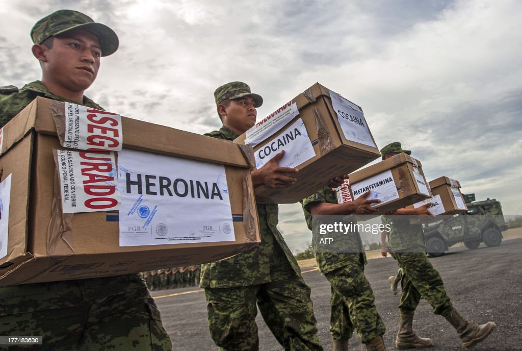 Members of the Mexican Army carry boxes with heroin cocaine and methamphetamine to be incinerated at a military base in Monterrey Nuevo Leon state on...