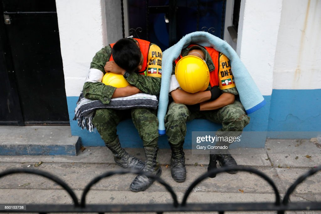 Members of the Mexican Army nap after assisting in the search and rescue of people trapped in collapsed buildings in Colonia Condesa in Mexico City, on Sept. 20, 2017. A powerful 7.1 earthquake rocked central Mexico on Tuesday, collapsing homes and bridges across hundreds of miles, killing at least 225 people.