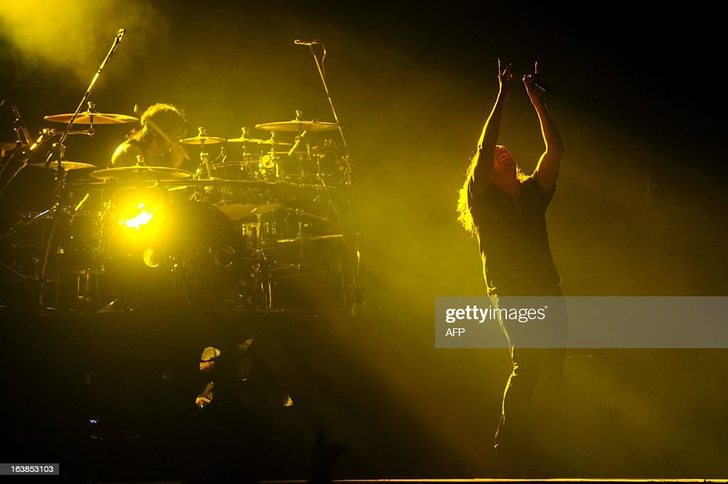 Members of the Mexican band Mana perform during the 'Drama y Luz' World Tour at the National Footbal Stadium in Managua on March 16, 2013. AFP PHOTO / Hector RETAMAL