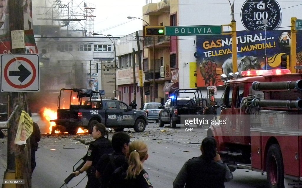 Members of the Mexican Federal Polcie arrive at the scene where a group of gunmen launched grenades at police on the main avenue of Ciudad Juárez in...