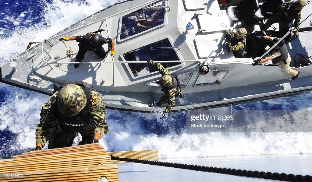 Members of the Mexican Navy approach a German combat support ship.