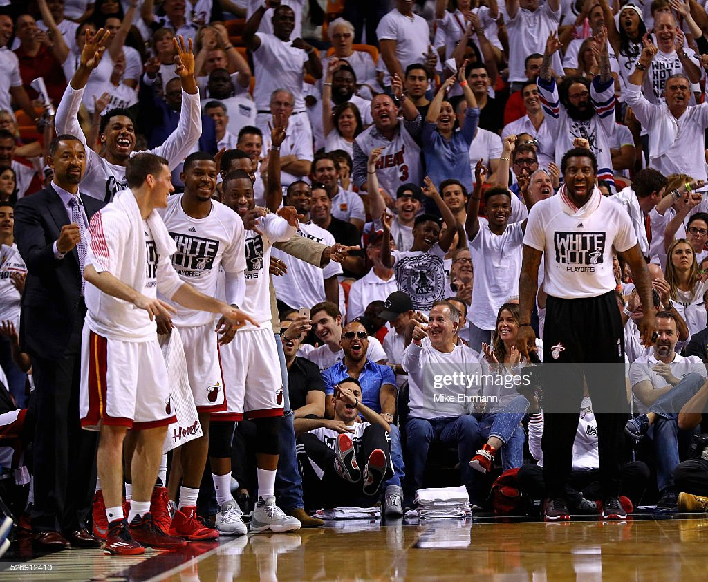 Members of the Miami Heat celebrate during Game Seven of the Eastern Conference Quarterfinals of the 2016 NBA Playoffs at American Airlines Arena on May 1, 2016 in Miami, Florida.