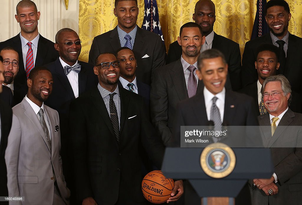 Members of the Miami Heat listen to U.S. President <a gi-track='captionPersonalityLinkClicked' href=/galleries/search?phrase=Barack+Obama&family=editorial&specificpeople=203260 ng-click='$event.stopPropagation()'>Barack Obama</a> (R) speak during an event to honor the NBA champion Miami Heat in the East Room at the White House on January 28, 2013 in Washington, DC. President <a gi-track='captionPersonalityLinkClicked' href=/galleries/search?phrase=Barack+Obama&family=editorial&specificpeople=203260 ng-click='$event.stopPropagation()'>Barack Obama</a> congratulated the 2012 NBA champions for claiming their third NBA Championship by beating the Boston Celtics.