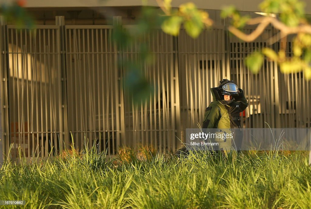 Members of the Miami Police Department's Bomb Squad investigate a package during a game between the Miami Marlins and the Chicago Cubs at Marlins Park on April 25, 2013 in Miami, Florida.
