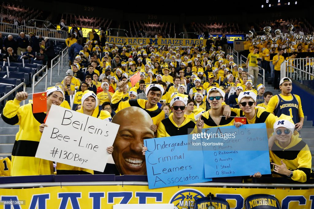 Members of the Michigan Maize Rage student section hold signs taunting UCLA and former player LiAngelo Ball before the start of a regular season non-conference basketball game between the UCLA Bruins and the Michigan Wolverines on December 9, 2017 at the Crisler Center in Ann Arbor, Michigan. Michigan defeated UCLA 78-69 in overtime.