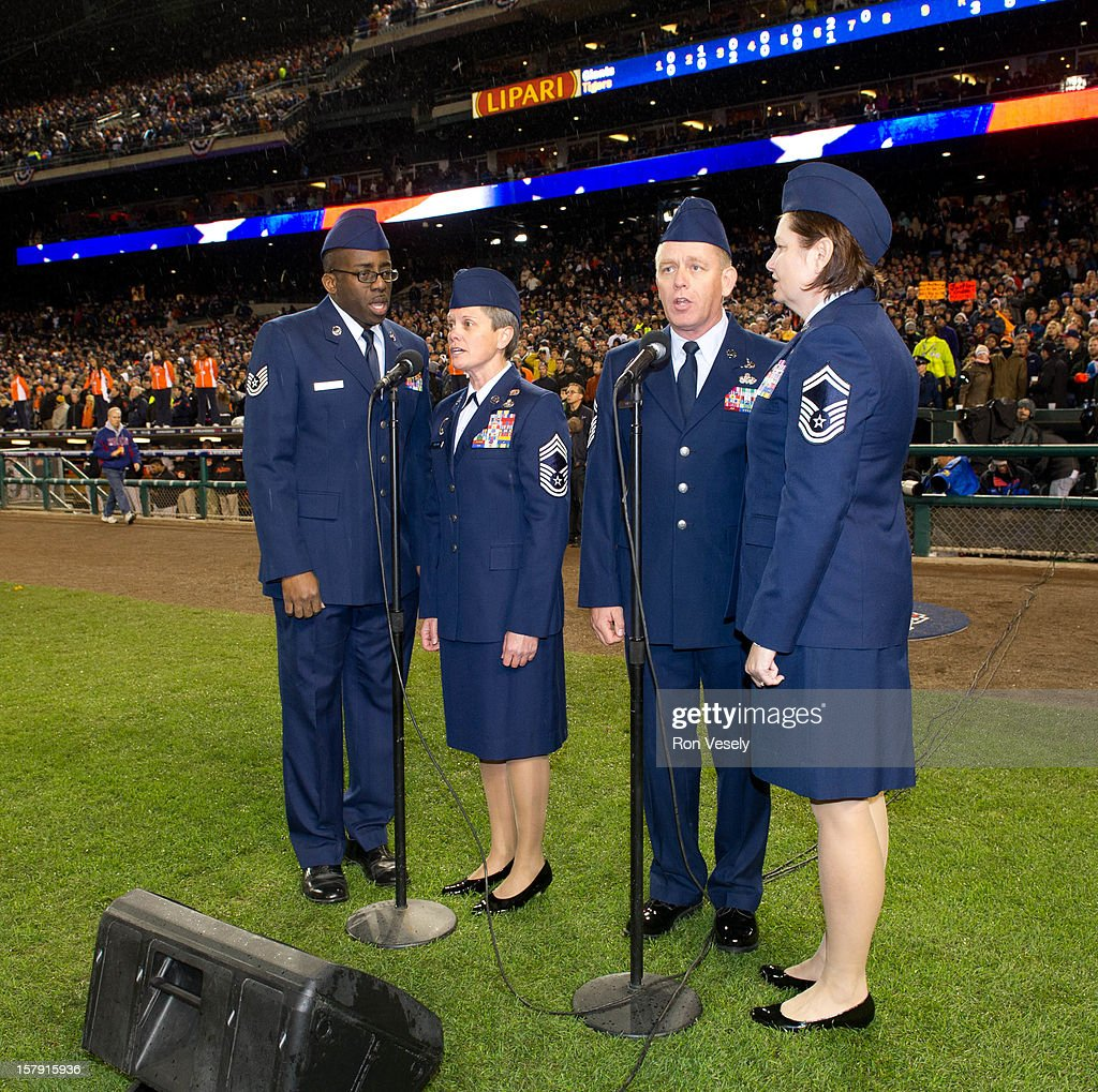 Members of the Michigan National Guard and of the signing group the110th Airlift Wing Knights in Blue sing God Bless American in the seventh inning of Game 4 of the 2012 World Series against the San Francisco Giants on Sunday, October 28, 2012 at Comerica Park in Detroit, Michigan.