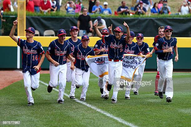Members of the MidAtlantic Team from New York do a victory lap after defeating the AsiaPacific Team from South Korea 21 in the World Series...