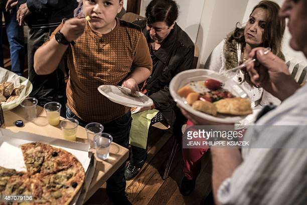 LAFFONT Members of the Mikho family Iraqi Christians who fled the city of Qaraqosh seized by the jihadist group Islamic State in 2014 have dinner as...