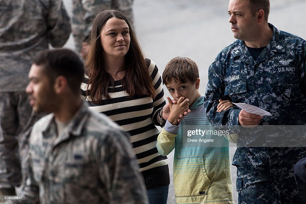 Members of the military and family arrive for a comedy show organized by United Services Organizations (USO) for members of the military and their families, at Andrews Air Force Base, May 5, 2016, in Joint Base Andrews, Maryland. The program is also being live streamed for active duty service members stationed at bases domestically and abroad.