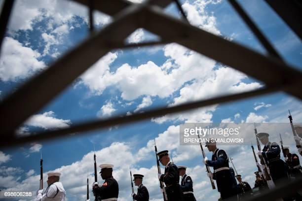 Members of the military arrive before US Secretary of Defense James Mattis greets Ukraine's President Petro Poroshenko outside the Pentagon on June...