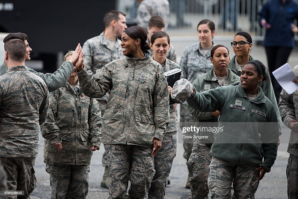 Members of the military arrive for a comedy show organized by United Services Organizations (USO) for members of the military and their families, at Andrews Air Force Base, May 5, 2016, in Joint Base Andrews, Maryland. The program is also being live streamed for active duty service members stationed at bases domestically and abroad.