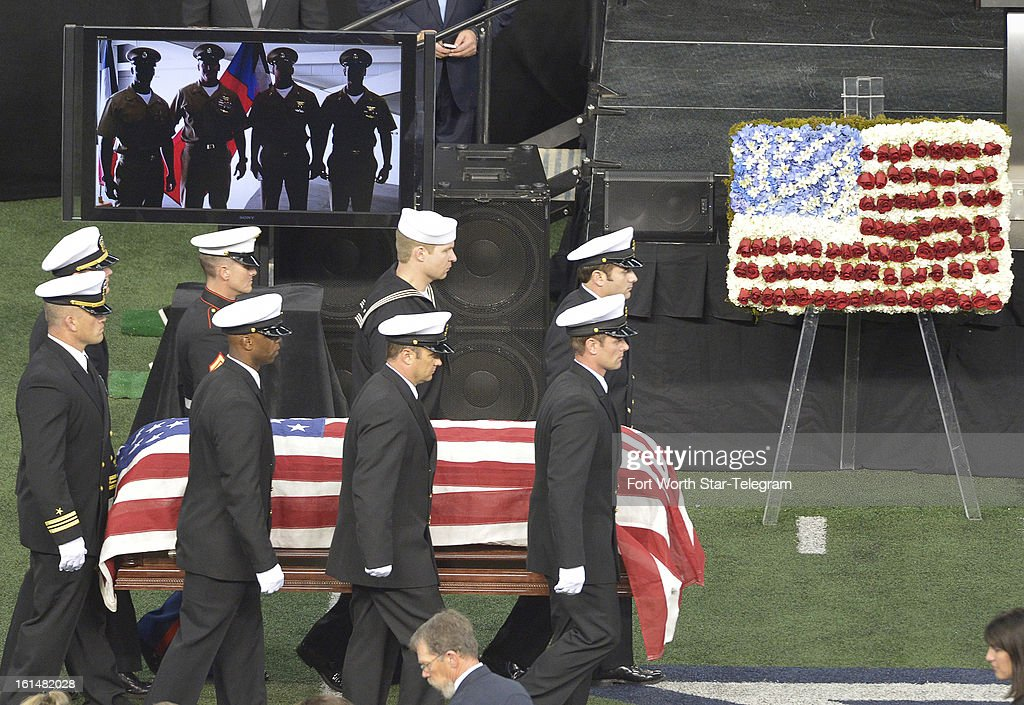 Members of the military carry the casket of Chris Kyle at Cowboys Stadium in Arlington, Texas, Monday, February 11, 2013. Kyle was a highly decorated former Navy SEAL sniper who was shot and killed at a shooting range last week.