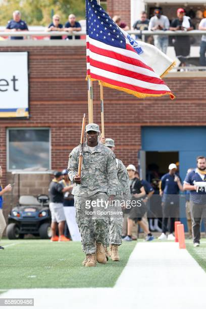 Members of the military comes onto the field before the game the college football game between the Furman Paladins and the UT Chattanooga Mocs on...