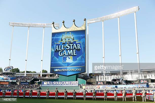 Members of the military hold the American flag before the 83rd MLB AllStar Game at Kauffman Stadium on July 10 2012 in Kansas City Missouri