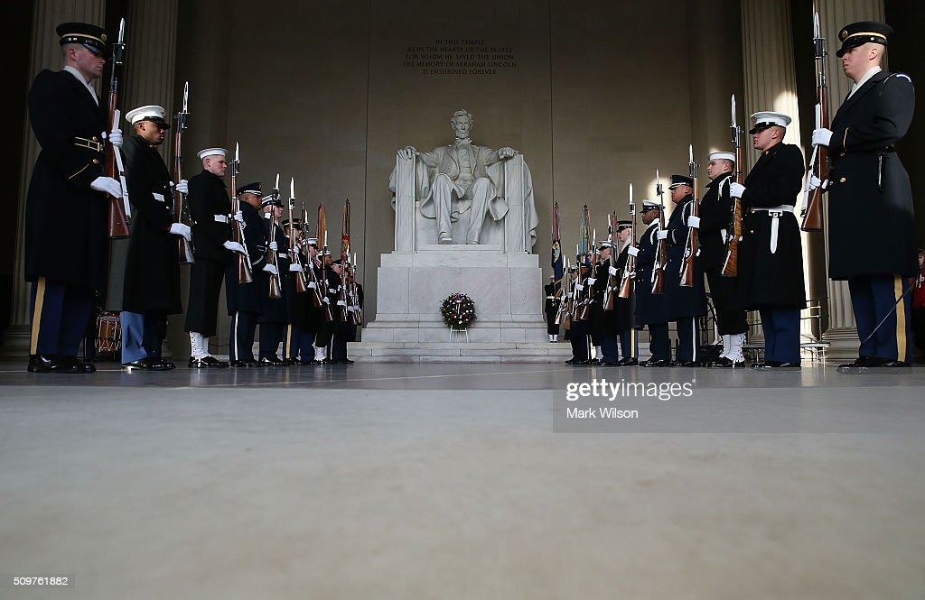 Members of the military participate in a wreath laying ceremony at the Lincoln Memorial, February 12, 2016 in Washington, DC. The Military District of Washington held a Presidential full honor wreath laying ceremony to commemorate Abraham Lincoln's 207th birthday.