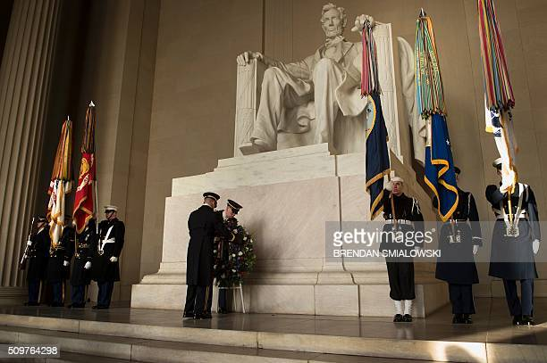 Members of the military place a wreath to honor Abraham Lincoln's 207th birthday at the Lincoln Memorial February 12 2016 in Washington DC / AFP /...