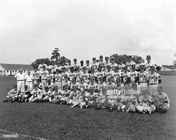 Members of the Milwaukee Braves pose for a team portrait during a Spring Training in March 1957 in Sarasota Florida Some players that are pictured...