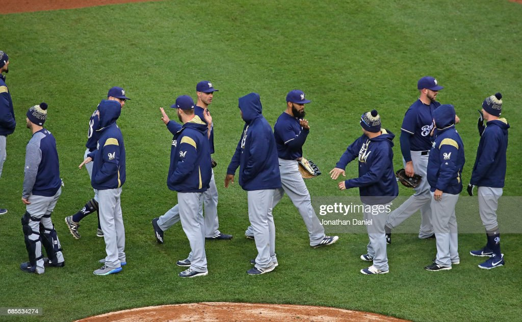 Members of the Milwaukee Brewers celebrate a win over the Chicago Cubs at Wrigley Field on May 19, 2017 in Chicago, Illinois. The Brewers defeated the Cubs 6-3.