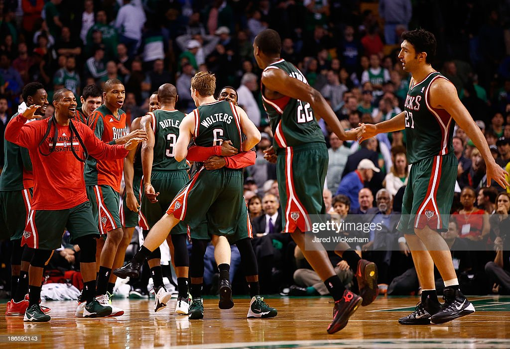Members of the Milwaukee Bucks including <a gi-track='captionPersonalityLinkClicked' href=/galleries/search?phrase=O.J.+Mayo&family=editorial&specificpeople=2351505 ng-click='$event.stopPropagation()'>O.J. Mayo</a> #00 and <a gi-track='captionPersonalityLinkClicked' href=/galleries/search?phrase=Nate+Wolters&family=editorial&specificpeople=9023990 ng-click='$event.stopPropagation()'>Nate Wolters</a> #6 celebrate in the fourth quarter after taking the lead against the Boston Celtics during the home opener at TD Garden on November 1, 2013 in Boston, Massachusetts.