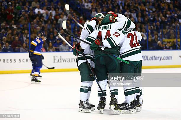Members of the Minnesota Wild celebrate after scoring a goal against the St Louis Blues in Game Five of the Western Conference Quarterfinals during...