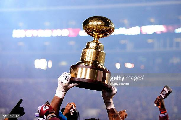 Members of the Mississippi State Bulldogs hold the 'Golden Egg' trophy following a victory over the Ole Miss Rebels at Davis Wade Stadium on November...