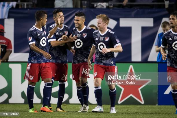 Members of the MLS AllStar team congratulate Dom Dwyer of United States during the MLS AllStar match between the MLS AllStars and Real Madrid at the...
