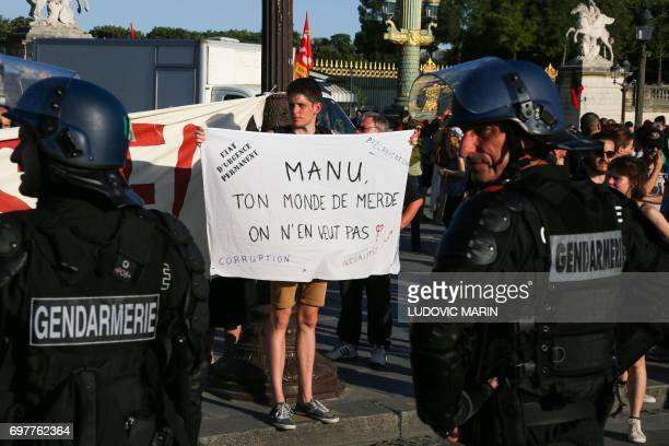 Members of the Mobile Gendarmerie a subdivision of the French national Gendarmerie hold off protesters attempting to change regular itinerary and go...