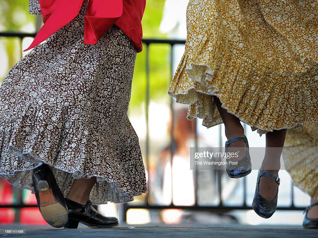 Members of the Monarca Dance Ensemble, a children's Mexican dance workshop, exhibit fancy footwork onstage during the annual Cinco de Mayo festival on the National Mall on May, 05, 2013 in Washington, DC.